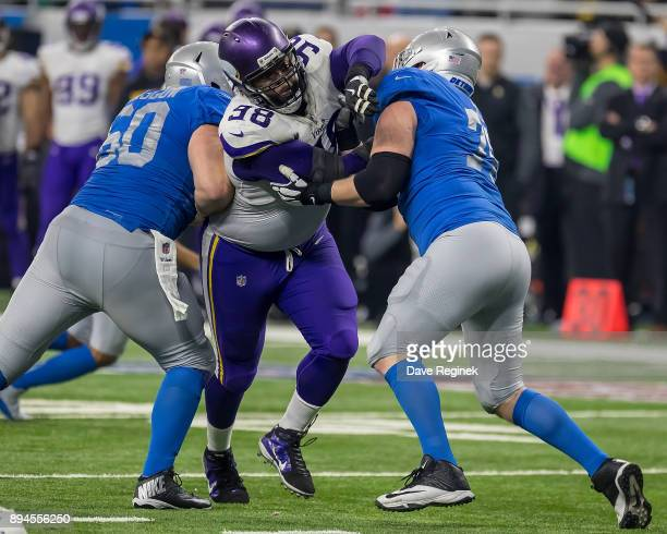 Linval Joseph of the Minnesota Vikings battles on the line with TJ Lang of the Detroit Lions during an NFL game at Ford Field on November 23 2016 in...