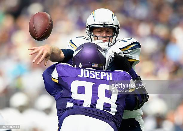 Linval Joseph of the Minnesota Vikings hits quarterback Kellen Clemens of the San Diego Chargers as he attempts to throw the ball during the second...