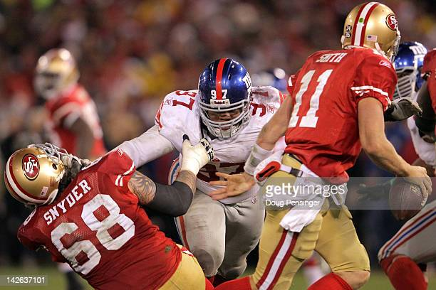 Linval Joseph of the New York Giants sheds the block of Adam Snyder of the San Francisco 49ers as Joseph applies a pas rush on quarterback Alex Smith...