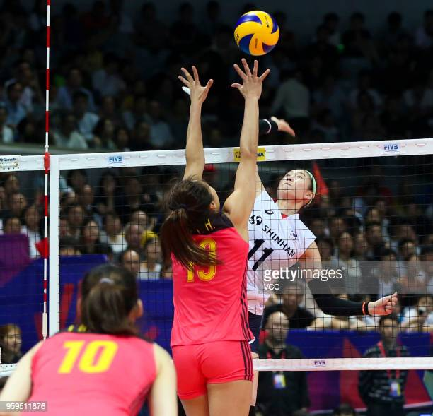 Linyu Diao of China defends against Su Ji Kim of South Korea during the FIVB Volleyball Nations League 2018 at Beilun Gymnasium on May 17 2018 in...