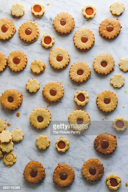 Linzer cookies with caramel on wood and marble