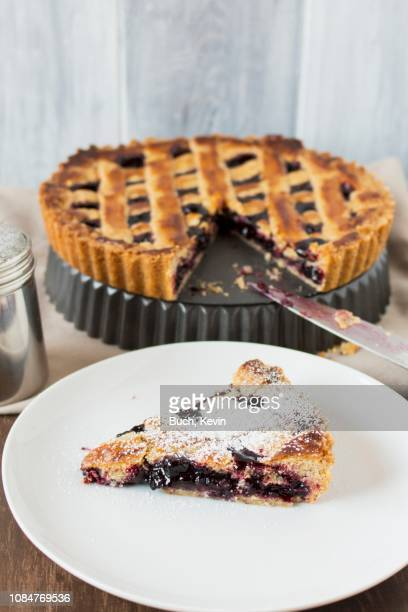 linzer torte, a piece on server - linz stock pictures, royalty-free photos & images