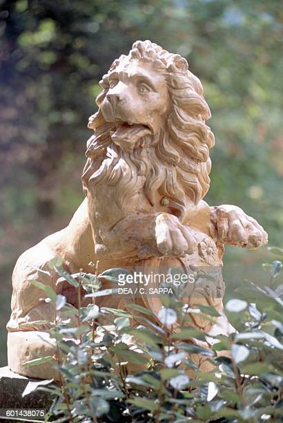 Lion a small statue in the garden of Chateau d'Etchauz SaintEtiennedeBaigorry France Aquitaine 11th16th century