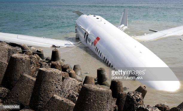 A Lion Air Boeing 737 lies partially submerged in the water two days after it crashed while trying to land at Bali's international airport near...
