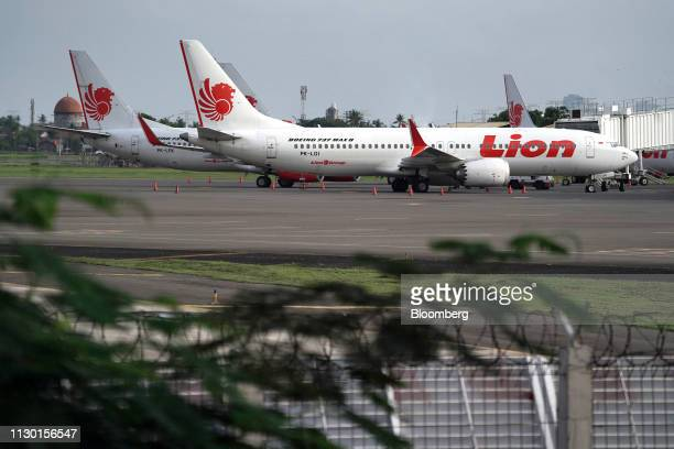 A Lion Air Boeing Co 737 Max 8 aircraft right stands on the tarmac at SoekarnoHatta International Airport in Cenkareng Indonesia on Tuesday March 12...