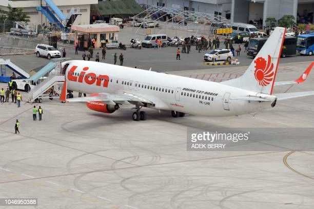 A Lion Air commercial plane arrives at the Mutiara Sis Al Jufri airport in Palu Indonesia's Central Sulawesi on October 7 following the September 28...