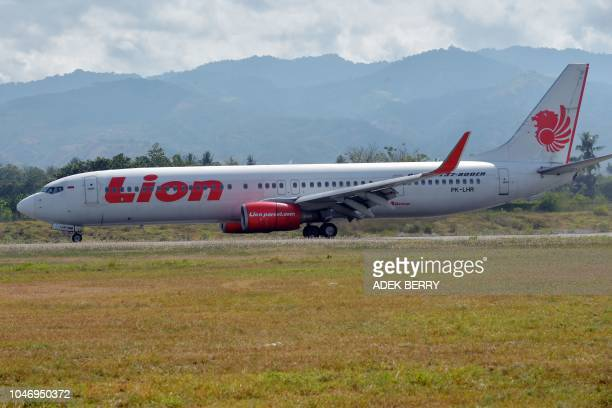 A Lion Air commercial plane lands at the Mutiara Sis Al Jufri airport in Palu Indonesia's Central Sulawesi on October 7 following the September 28...