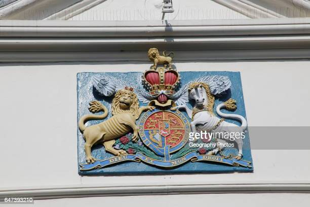 Lion and unicorn royal coat of arms 'Dieu et mon Droit' motto of monarchy seen in Falmouth Cornwall England UK