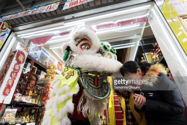 A lion dance is performed outside a shop in Yokohama China Town on February 5 2019 in Yokohama Japan Thousands of people gathered in the largest...