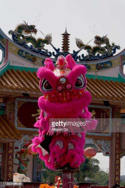 A lion dance performs during a Chinese New Year day of 13th celebration at the Tin Hong Si temple in Kajang on February 17 2019 in Kuala Lumpur...