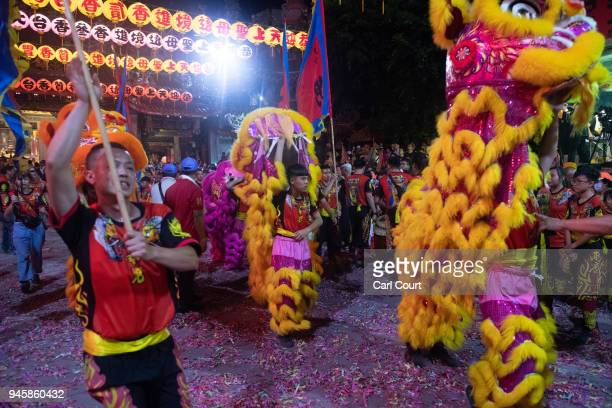 Lion dancers perform at Jenn Lann Temple during festivities marking the beginning of the nine day Mazu pilgrimage on April 13 2018 in Dajia near...