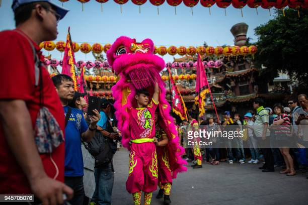 Lion dancers perform at Jenn Lann Temple in Dajia near Taichung as festivities begin to mark the nine day Mazu pilgrimage on April 13 2018 in...