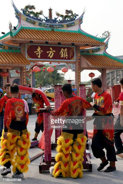 Lion dancers prepare to perform during a Chinese New Year day of 13th celebration at the Tin Hong Si temple in Kajang on February 17 2019 in Kuala...