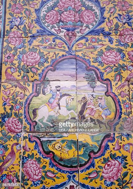 Lion hunt, polychrome tile decoration on the front of Qavam house also known as Narenjestan e Ghavam, 1879-1886, in the Eram garden or Paradise...