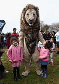 rotorua new zealand lion mascot poses