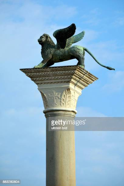 Lion of Saint Mark on a column at the St Mark's Square of Venice in Italy