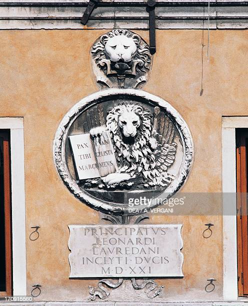 Lion of St Mark on the facade of a palace Venice Veneto Italy