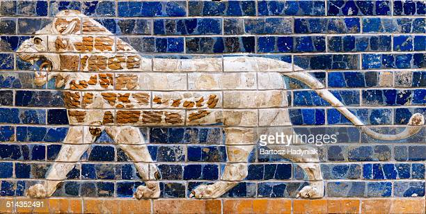 lion on brick panel from way to ishtar gate - ishtar gate stock photos and pictures