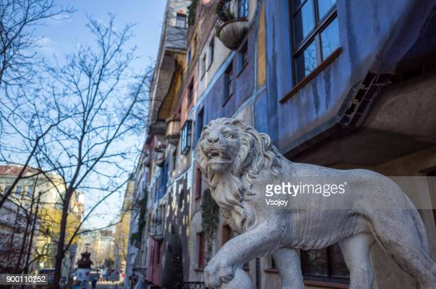 lion sculpture at the hundertwasser house, vienna, austria - vsojoy stock pictures, royalty-free photos & images