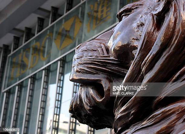 A HSBC lion statue stands outside the bank's headquarters in Hong Kong on February 28 2011 Banking giant HSBC said that its net profit more than...