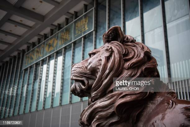 Lion statue stands outside the Hong Kong headquarters of HSBC in the Central district of Hong Kong on August 4, 2019. - HSBC on August 5, 2019 said...