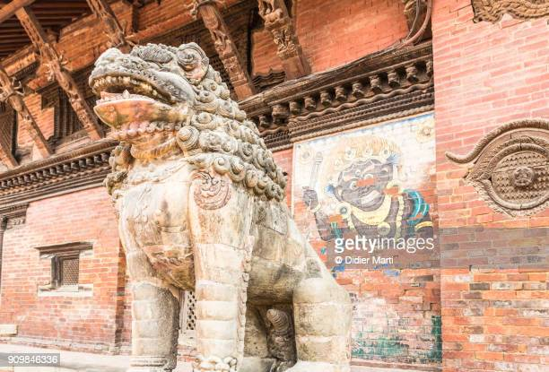 Lion stone statue guarding the entrance of a palace in the famous Patan Durbar square