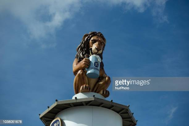 A lion with a beer of Loewenbraeu on day one of the Oktoberfest ceebrations in Munich Germany on 22 September 2018 The Oktoberfest is the world's...