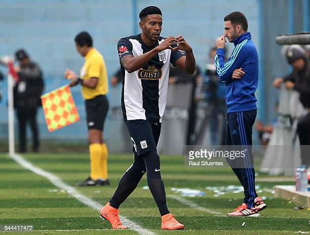 Lionard Pajoy of Alianza Lima celebrates after scoring the opening goal during a match between Sporting Cristal and Alianza Lima as part of Torneo...