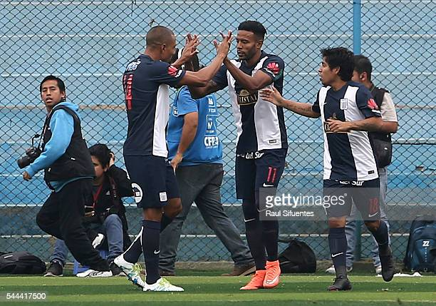 Lionard Pajoy of Alianza Lima celebrates with teammates after scoring the opening goal during a match between Sporting Cristal and Alianza Lima as...