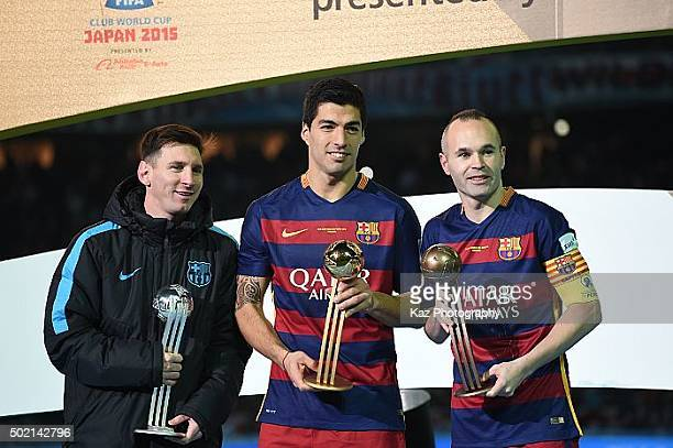 Lione Messi Luis Suarez and Andres Iniesta of FC Barcelona receive all individual awards during the FIFA Club World Cup Final match between River...