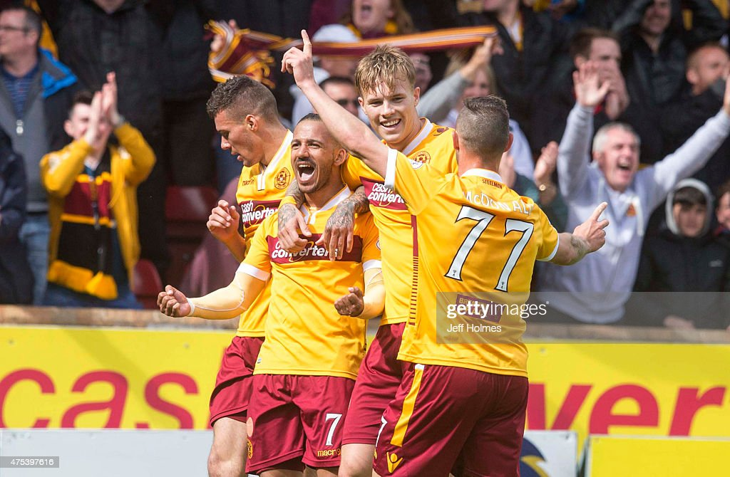 Lionel Ainsworth (2L) of Motherwell celebrates his goal making it 2:0 with team mates during the Scottish Premiership play-off final 2nd leg between Motherwell and Rangers at Fir Park on May 31, 2015 in Motherwell, Scotland.