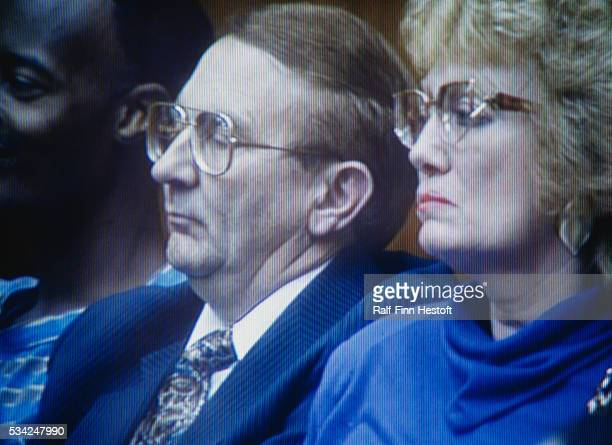 Lionel and Shari Dahmer the father and stepmother respectively of serial killer Jeffrey Dahmer watch their son's murder trial Dahmer stood trial for...