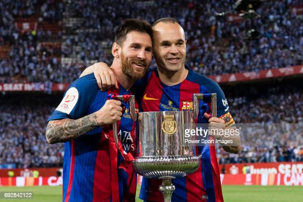 Lionel Andres Messi of FC Barcelona and Andres Iniesta Lujan of FC Barcelona poses for photos with the trophy of Copa Del Rey after the final between...