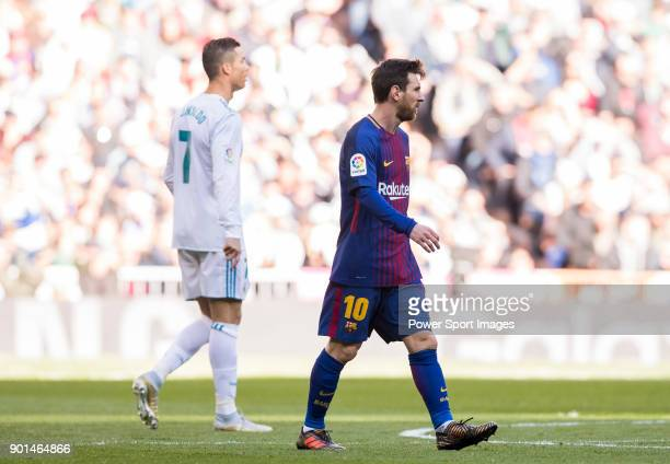 Lionel Andres Messi of FC Barcelona and Cristiano Ronaldo of Real Madrid look on during the La Liga 201718 match between Real Madrid and FC Barcelona...