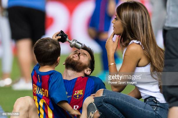 Lionel Andres Messi of FC Barcelona and his son Thiago and wife Antonella during the Copa Del Rey Final between FC Barcelona and Deportivo Alaves at...