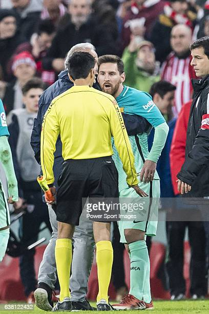 Lionel Andres Messi of FC Barcelona argues with the assistant referee during their Copa del Rey Round of 16 first leg match between Athletic Club and...