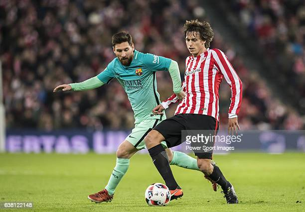 Lionel Andres Messi of FC Barcelona battles for the ball with Ander Iturraspe Derteano of Athletic Club during their Copa del Rey Round of 16 first...
