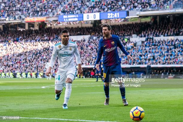 Lionel Andres Messi of FC Barcelona battles for the ball with Carlos Henrique Casemiro of Real Madrid during the La Liga 201718 match between Real...