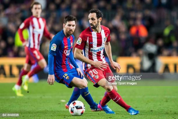 Lionel Andres Messi of FC Barcelona battles for the ball with Juan Francisco Torres Belen, Juanfran, of Atletico de Madrid during their Copa del Rey...