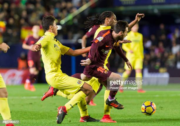 Lionel Andres Messi of FC Barcelona battles for the ball with Rodrigo Hernandez Cascante Rodri and Ruben Afonso Borges Semedo of Villarreal CF during...