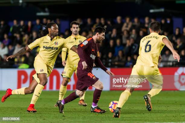 Lionel Andres Messi of FC Barcelona battles for the ball with Ruben Afonso Borges Semedo of Villarreal CF during the La Liga 201718 match between...