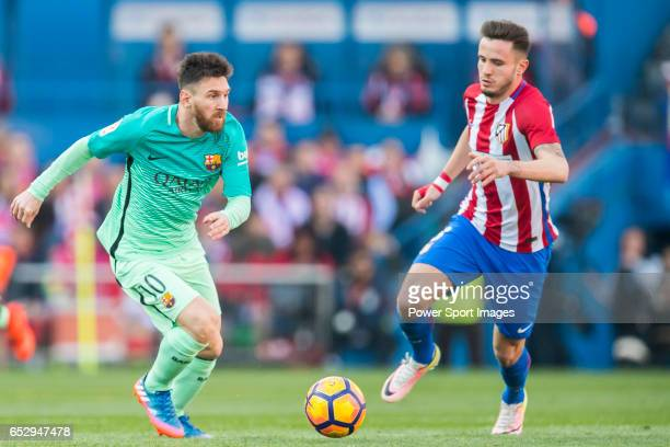 Lionel Andres Messi of FC Barcelona battles for the ball with Saul Niguez Esclapez of Atletico de Madrid during their La Liga match between Atletico...