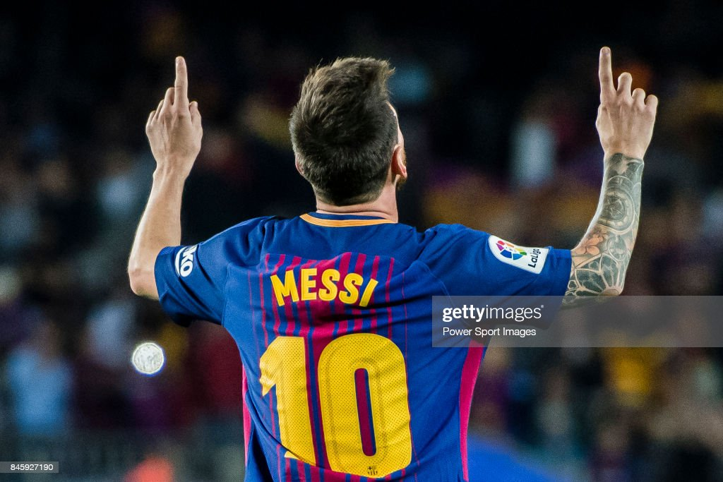 Lionel Andres Messi of FC Barcelona celebrates his hat trick ...