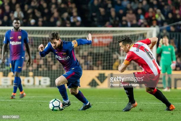 Lionel Andres Messi of FC Barcelona fights for the ball with Alex Granell Nogue of Girona FC in action during the La Liga 201718 match between FC...