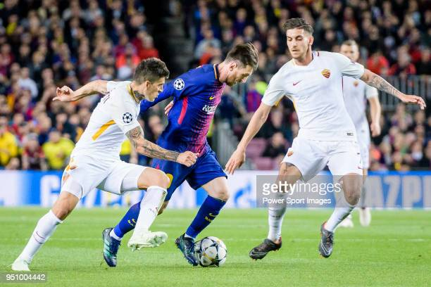Lionel Andres Messi of FC Barcelona fights for the ball with Diego Perotti of AS Roma and Lorenzo Pellegrini of AS Roma during the UEFA Champions...