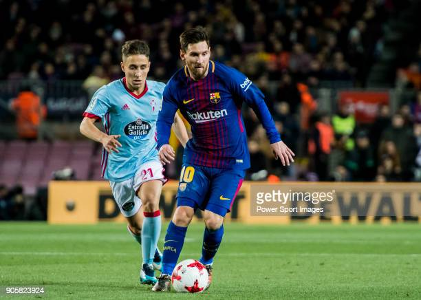 Lionel Andres Messi of FC Barcelona fights for the ball with Emre Mor of RC Celta de Vigo during the Copa Del Rey 201718 Round of 16 match between FC...