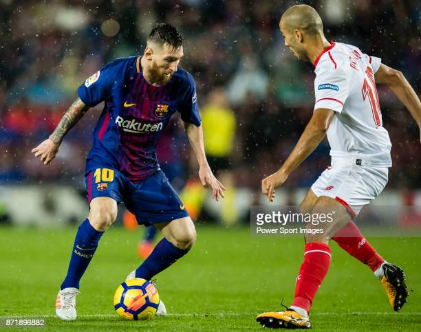 Lionel Andres Messi of FC Barcelona fights for the ball with Guido Hernan Pizarro of Sevilla FC during the La Liga 201718 match between FC Barcelona...