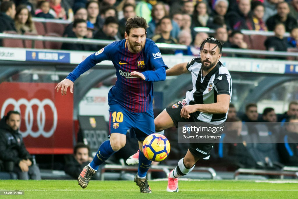 Lionel Andres Messi (L) of FC Barcelona fights for the ball with Ivan Lopez Alvarez, Ivi, of Levante UD during the La Liga match between FC Barcelona and Levante UD at Camp Nou on 07 January 2018 in Barcelona, Spain.
