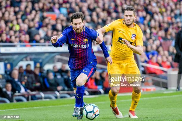 Lionel Andres Messi of FC Barcelona fights for the ball with Jorge Resurreccion Merodio Koke of Atletico de Madrid during the La Liga 201718 match at...