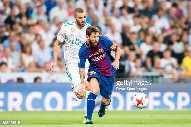 MADRID SPAIN AUGUST 16 Lionel Andres Messi of FC Barcelona fights for the ball with Karim Benzema of Real Madrid during their Supercopa de Espana...